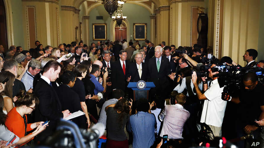Senate Majority Leader Mitch McConnell of Kentucky, center, speaks during a news conference on Capitol Hill in Washington, July 18, 2017.