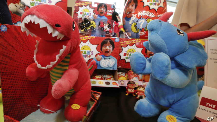 FILE - Ryan's World toys, from Bonkers Toys, are displayed at the The Toy Insider Sweet Suite show, in New York, July 11, 2018.