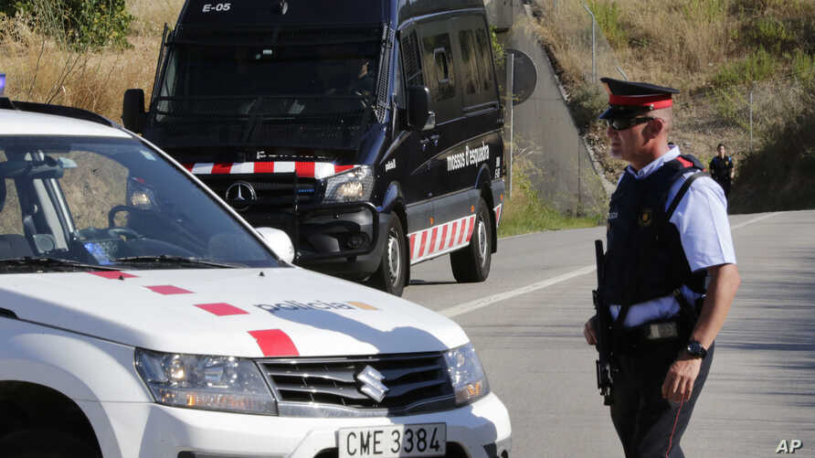 Armed police officers stand guard near Subirats, Spain, Aug. 21, 2017.