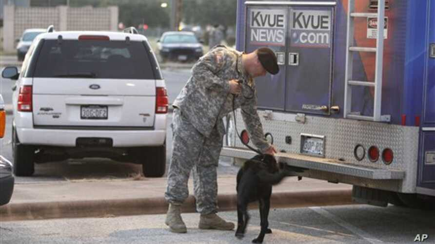 A television news vehicle undergoes  a security check outside the U.S. Magistrate court where an Article 32 hearing for Major Nidal Hasan begins 12 Oct 2010 in Fort Hood, Texas