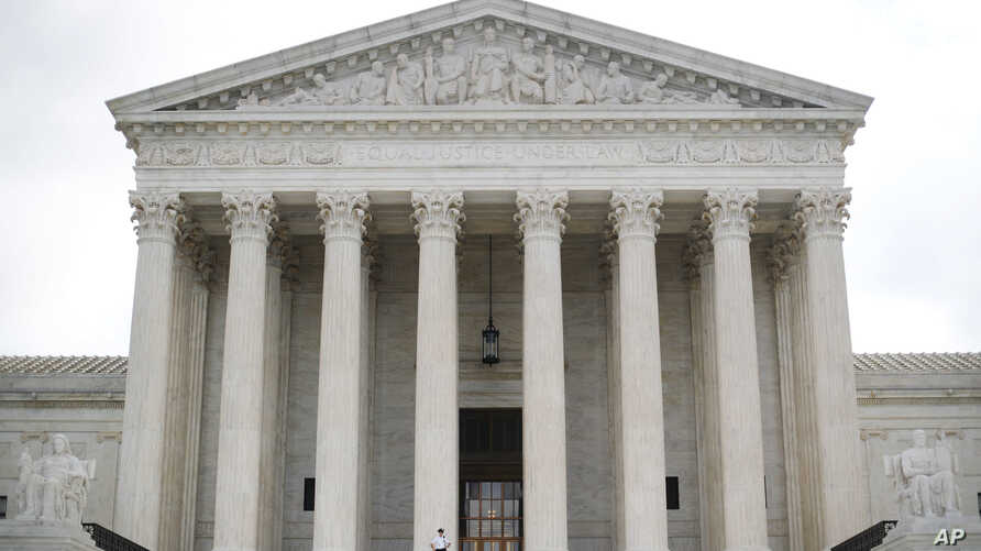 A police officer guards the main entrance to the Supreme Court in Washington, Oct. 9, 2018.