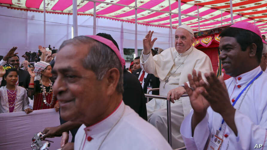 Pope Francis arrives on a cycle rickshaw at an event to meet representatives of different religions in Dhaka, Bangladesh, Friday, Dec. 1, 2017.