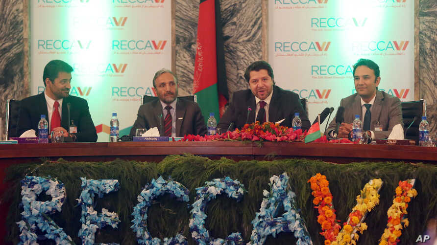 Deputy Foreign Minister Hekmat Khalil Karzai, second right, talks during the opening ceremony of the 6th Regional Economic Cooperation Conference of Afghanistan (RECCA) at the foreign affairs ministry in Kabul, Afghanistan, Sept. 3, 2015.