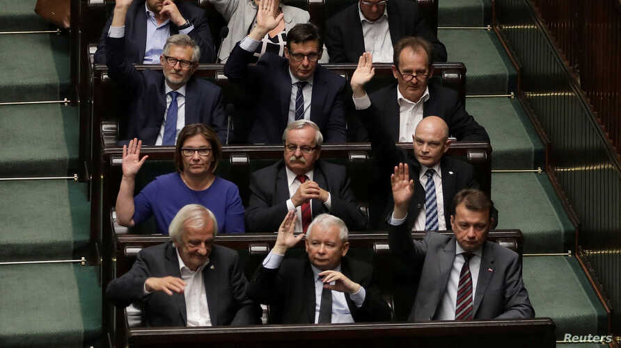 FILE - Leader of Law and Justice (PiS) party Jaroslaw Kaczynski votes on a contested Supreme Court law in Warsaw, Poland, July 20, 2017.
