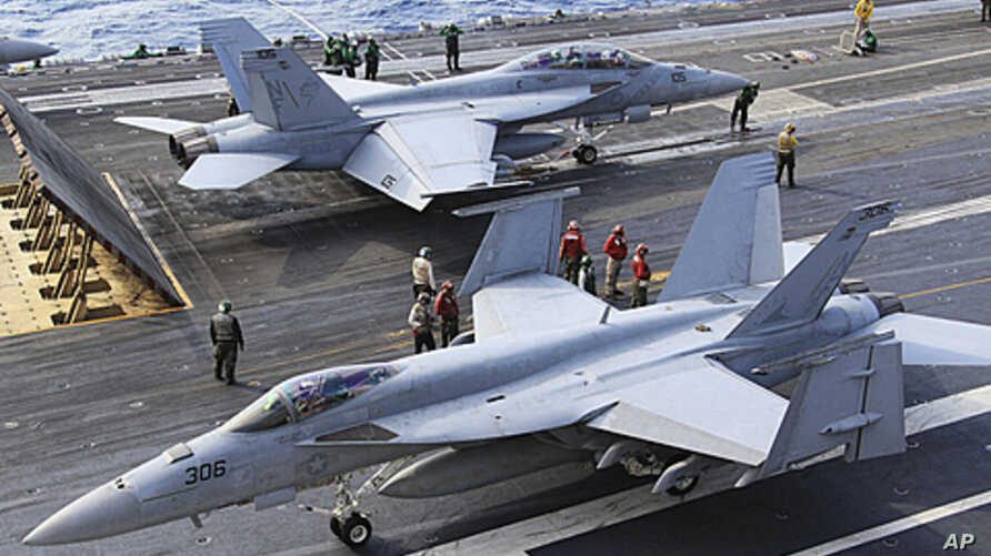 FA-18 air fighters prepare to take off on the U.S. carrier George Washington in the Pacific near Minamidaito Island in Okinawa Prefecture, southern Japan, during a joint drill with the Japanese Self-Defense Forces. (2010 File)