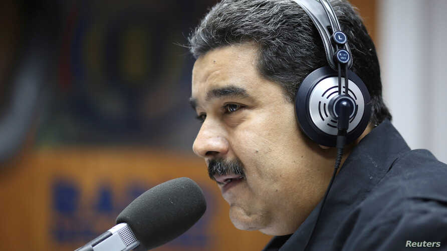 Venezuela's President Nicolas Maduro speaks during his radio program at Miraflores Palace in Caracas, Venezuela Dec. 26, 2016.
