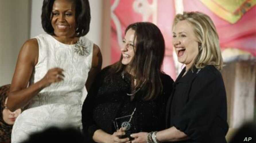 Secretary of State Hillary Rodham Clinton and first lady Michelle Obama present the 2012 International Women of Courage Award to Safak Pavey of Turkey, on the 101st Anniversary of International Women's Day, March 8, 2012, at the State Department in W