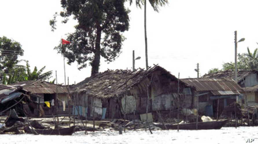 Shacks and houses line the shores of a river in Nigeria's Delta region. Militancy was born of resentment in the Niger Delta, where multi-billion dollar oil installations sit among villages of shacks perched on stilts over viscous, blackened water, Ap