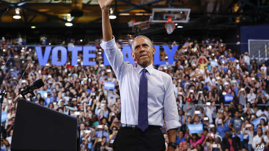 President Barack Obama waves to supporters at Florida International University in Miami, Nov. 3, 2016, during a campaign rally for Democratic presidential candidate Hillary Clinton.