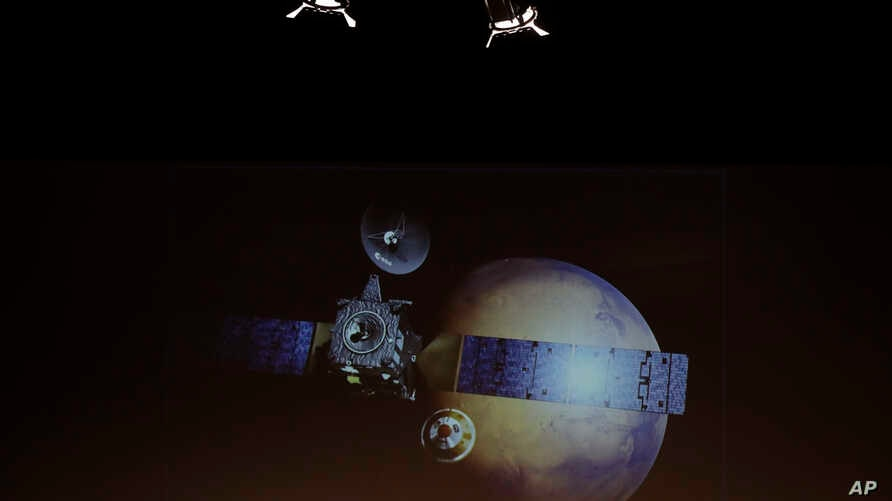 A rendering of the Schiaparelli Space Module and of the planet Mars is displayed on a movie screen, during an event on the occasion of the insertion of the Trace Gas Orbiter into orbit around Mars, and landing of the Schiaparelli module on the surfac