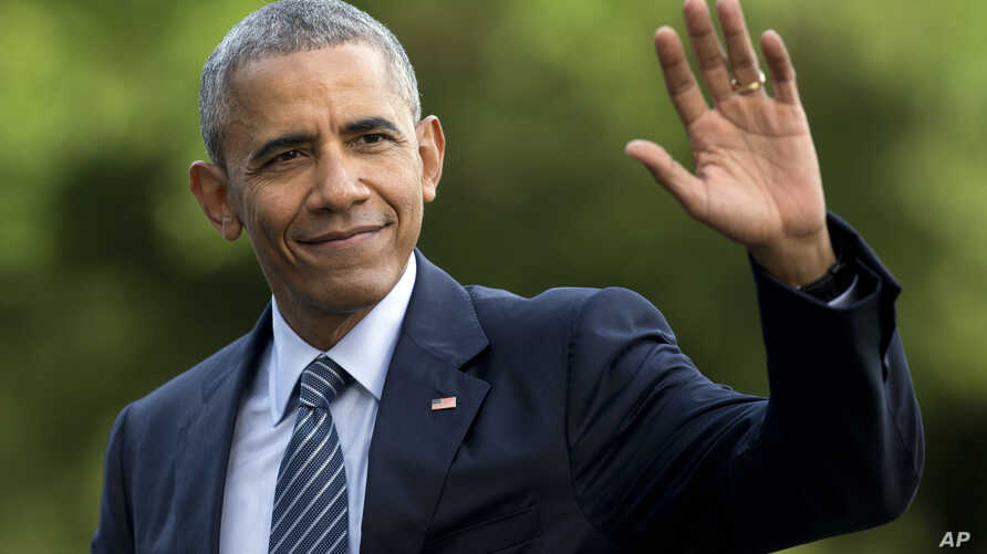 FILE - President Barack Obama waves as he walks across the South Lawn of the White House, in Washington, as he returns from Charlotte, N.C. where he participated in a campaign event with Democratic presidential candidate Hillary Clinton,  July 5, 201