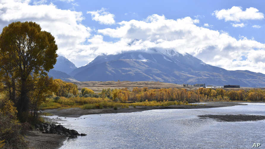 Emigrant Peak is seen rising above the Paradise Valley and the Yellowstone River near Emigrant, Montana, Oct. 8, 2018.