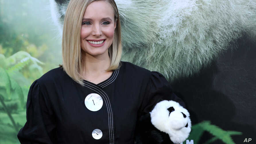 """FILE - Kristen Bell holds a panda teddy bear at the LA Premiere of """"Pandas"""" at the TCL Chinese Theatre IMAX on March 17, 2018, in Los Angeles."""