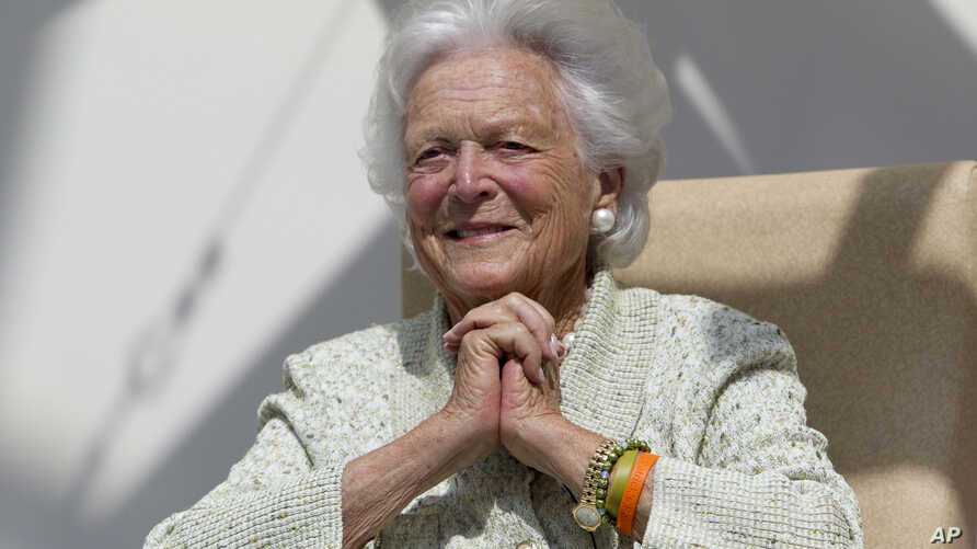 FILE - former first lady Barbara Bush listens to a patient's question during a visit to the Barbara Bush Children's Hospital at Maine Medical Center in Portland, Maine.