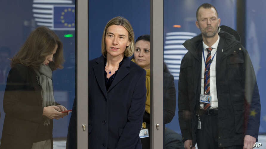 European Union foreign policy chief Federica Mogherini, center, arrives for a meeting of EU foreign ministers at the EU Council building in Brussels, Belgium, Feb. 6, 2017.