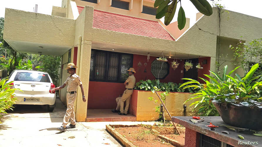 Police stand guard at the house of Gauri Lankesh, a senior Indian journalist who according to police was shot dead on Tuesday by unidentified assailants