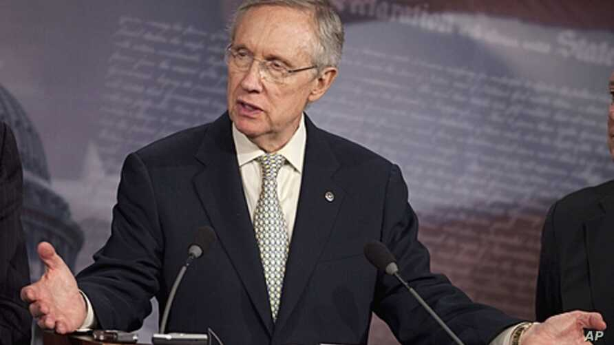 Senate Majority Leader Harry Reid gestures during a news conference on Capitol Hill in Washington, July 29, 2011