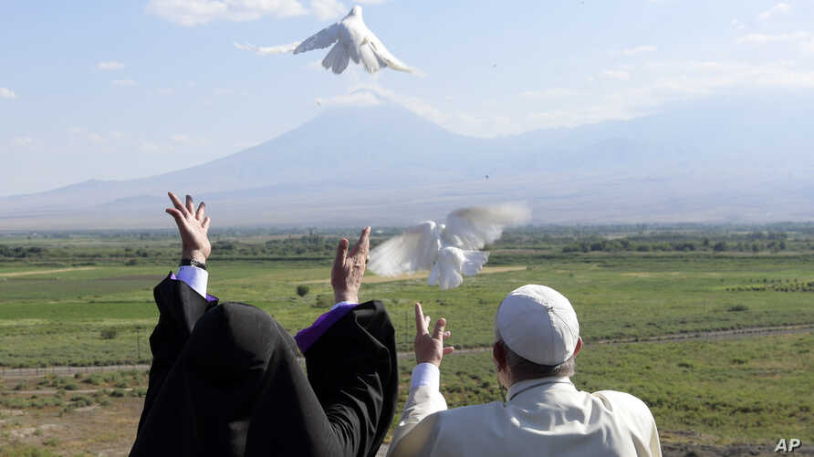Pope Francis, right, and Catholicos Karekin II release white doves after a ceremony at the Khor Virap's monastery, Armenia, June 26, 2016. (L'Osservatore Romano/Pool photo via AP)