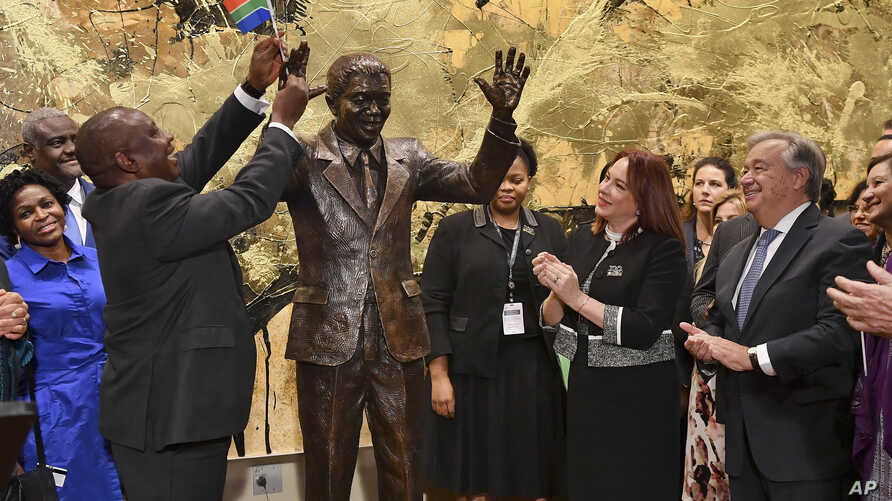South Africa President Cyril Ramaphosa, left, United Nations General Assembly President Maria Fernanda Espinosa, center, and United Nations Secretary General Antonio Guterres attend the unveiling ceremony of the Nelson Mandela Statue which was presen