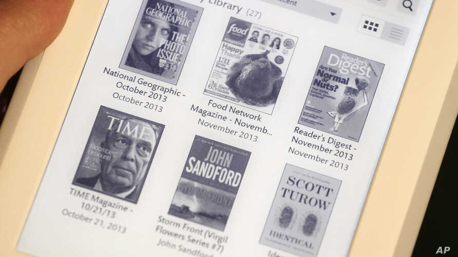 FILE - A Nook GlowLight e-reader is on dislplay at a demonstration in New York, Oct. 28, 2013.