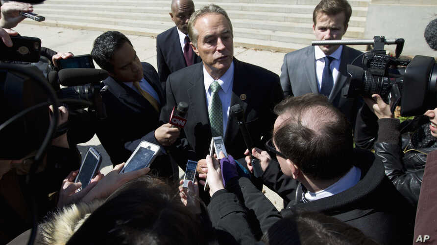 FILE - Rep. Chris Collins, R-N.Y., speaks with reporters in Washington, March 21, 2016.