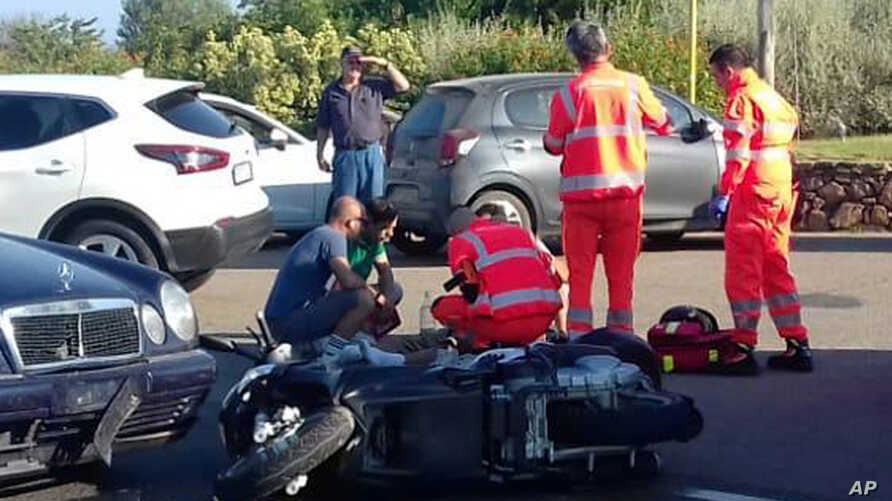Ambulance personnel tend to a man lying on the ground, later identified as actor George Clooney, after being involved in a scooter accident in the near Olbia, on the Sardinia island, Italy, July 10, 2018.