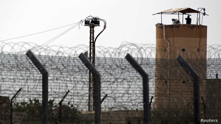 A member of Egypt's security forces stands on a watchtower in North Sinai as seen from across the border in southern Israel, July 1, 2015.