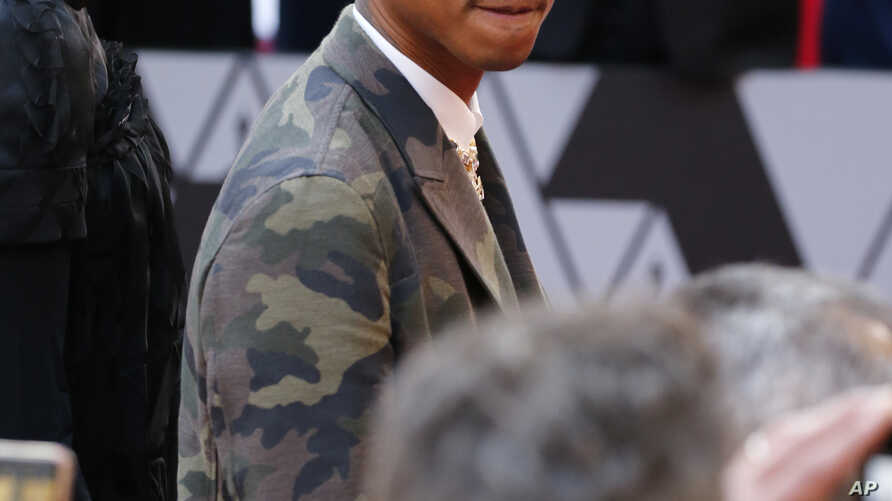 FILE - Pharrell Williams arrives at the Oscars on Feb. 24, 2019, at the Dolby Theatre in Los Angeles, California.