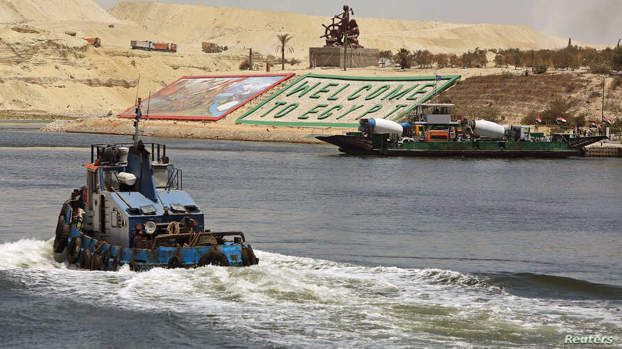 Security personnel cross through the New Suez Canal, Ismailia, Egypt, July 29, 2015.