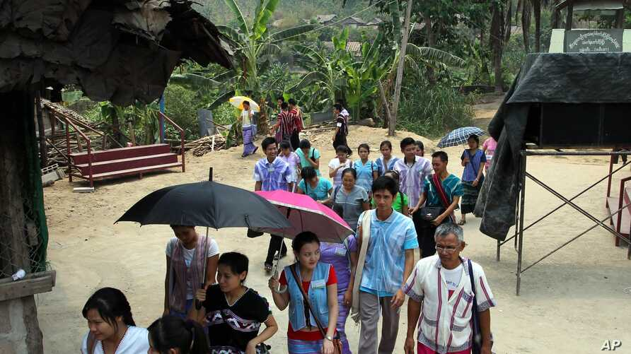 FILE - Karen refugees leave after a church service at Mae La refugee camp in Ta Song Yang district of Tak province, northern Thailand, April 12, 2013. With the end of military rule in Myanmar, aid groups are beginning to prepare for the eventual retu