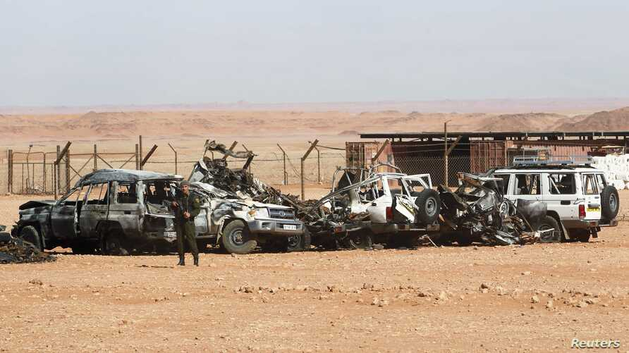 Algerian soldier stands near damaged cars used by Islamist militants during siege near the Tiguentourine Gas Plant, In Amenas, Jan. 31, 2013.