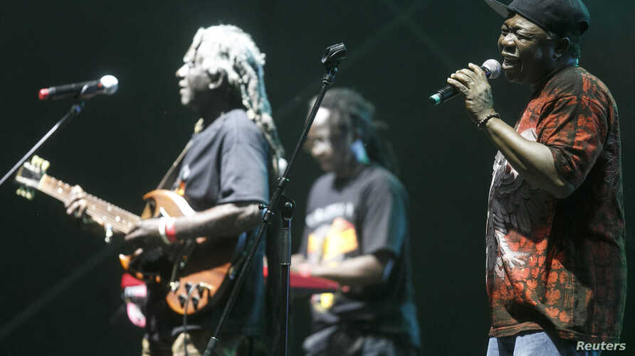 Reuben Koroma, right, and other members of Sierra Leone's Refugee All Stars perform in Gdynia, northern Poland, July 25, 2014.