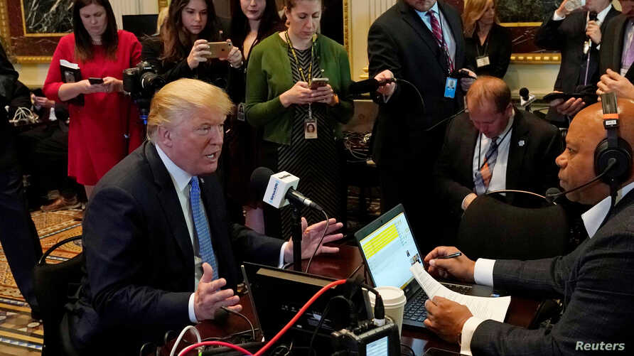 U.S. President Donald Trump answers a question during a radio interview on tax reform at the White House in Washington, Oct. 17, 2017.