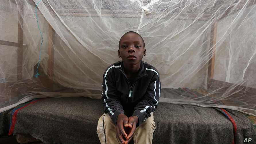 FILE - A Nigerian boy is pictured sitting on his bed at the Children's Rights and Rehabilitation Network in Eket, Nigeria.