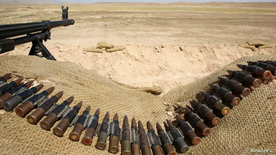 FILE - Bullets lie next to a gun at a Sinjar Resistance Units (YBS) check point, a militia affiliated with the Kurdistan Workers' Party (PKK), in the village of Umm al-Dhiban, northern Iraq, April 30, 2016.
