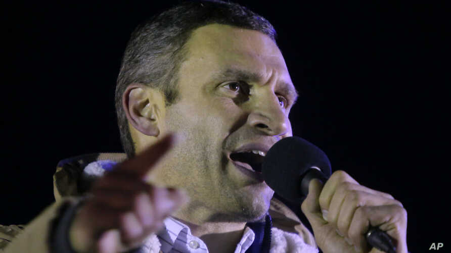 Ukrainian lawmaker and chairman of the Ukrainian opposition party Udar (Punch), WBC heavyweight boxing champion Vitaly Klitschko addresses supporters during a rally at the central Independence square in Kyiv, Ukraine, on Monday, Dec. 2, 2013.