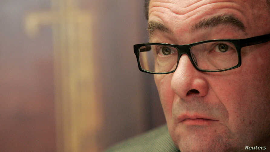 FILE: Austrian writer Robert Menasse listens to journalists' questions during a news conference in Vienna, Dec. 10, 2007.