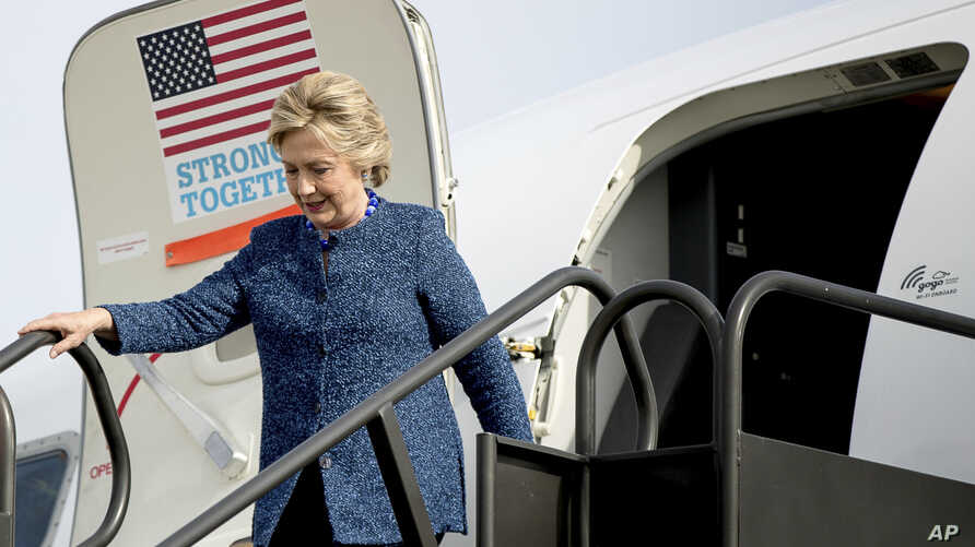 Campaign 2016 Clinton: Democratic presidential candidate Hillary Clinton arrives at Eastern Iowa Airport in Cedar Rapids, Iowa, Friday, Oct. 28, 2016, to attend a rally.