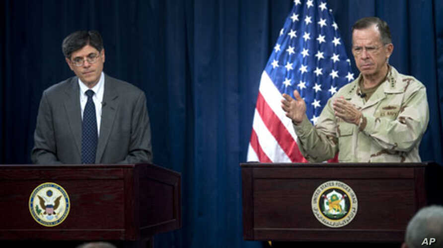 Navy Adm. Mike Mullen, chairman of the Joint Chiefs of Staff, and Deputy Secretary of State Jacob Lew address the media at the Combined Press Information Center in Baghdad, Iraq, 27 Jul 2010