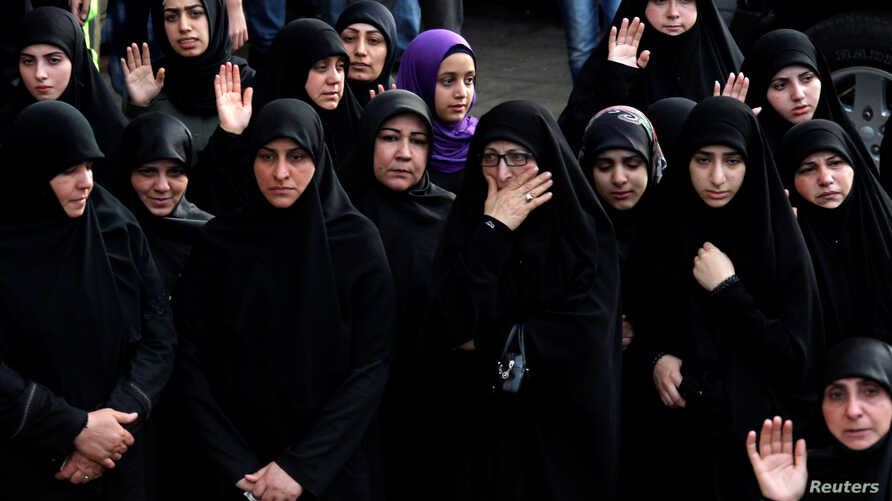 Women mourn during the funeral of top Hezbollah commander Mustafa Badreddine, who was killed in an attack in Syria, in Beirut's southern suburbs, Lebanon, May 13, 2016.