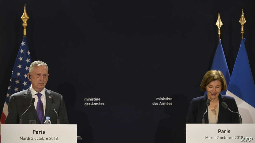 French Defense Minister Florence Parly speaks next to US Defense Secretary Jim Mattis during a press conference after their meeting at the French Defence ministry in Paris on Oct. 2, 2018.