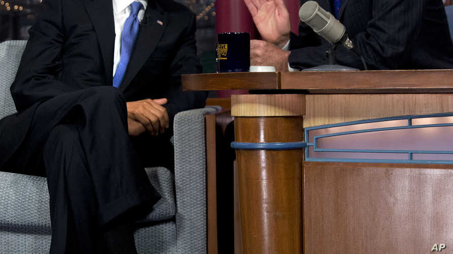 """President Barack Obama talks with David Letterman on the set of the """"Late Show With David Letterman"""" in New York, Sept. 18, 2012."""