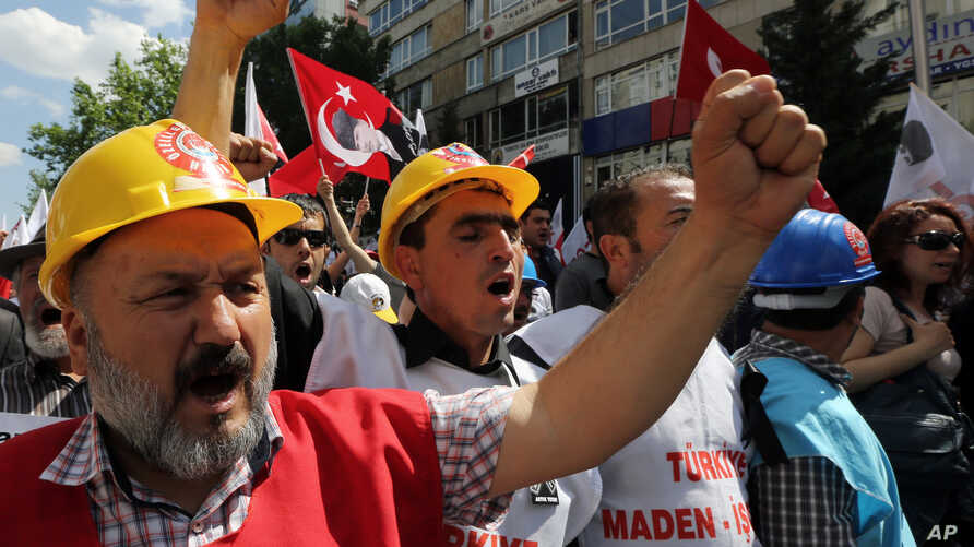 Miners join nearly 2,000 university students, some wearing miners' hard-hats, who called on the government to resign in Ankara, Turkey, May 19, 2014.