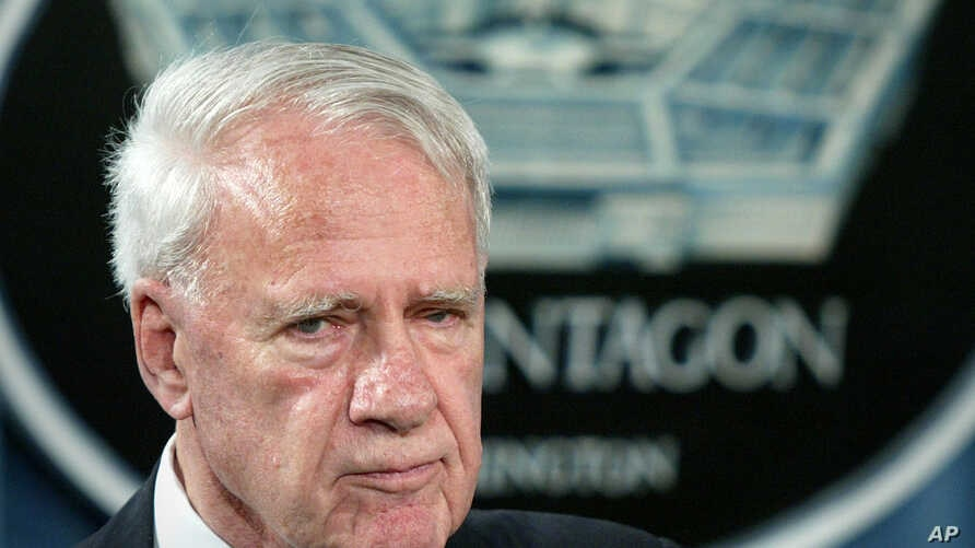 FILE - A 2004 photo shows former Defense Secretary James Schlesinger, chairman of the Detention Operations Review Panel speaking at the Pentagon.