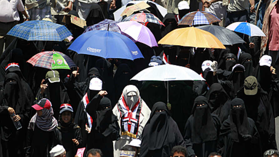 Women march during a demonstration demanding the ouster of Yemen's President Ali Abdullah Saleh in the southern city of Taiz, April 16, 2011