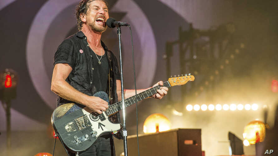 FILE - Eddie Vedder of Pearl Jam performs at Bonnaroo Music and Arts Festival in Manchester, Tenn., June 11, 2016.