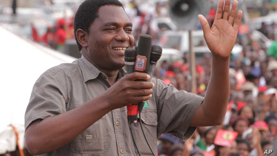 FILE -- In this Jan. 2015, photo Hakainde Hichilema, of the Zambia opposition United Party for National Development, addresses an election rally in Lusaka, Zambia. Hichilema was detained in April on treason charges