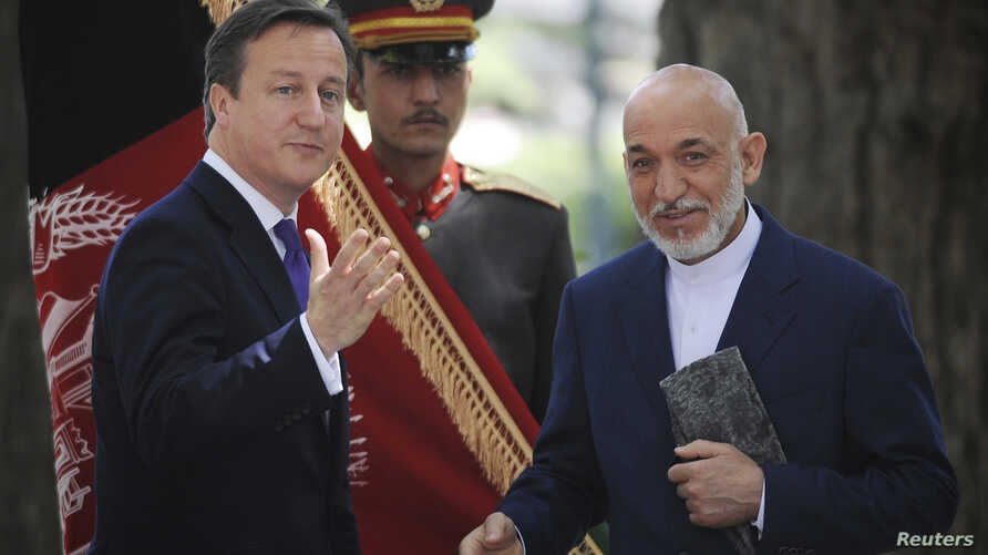Britain's Prime Minister David Cameron (L) attends a news conference with Afghan President Hamid Karzai at the Presidential Palace in Kabul, Afghanistan, July 19, 2012.
