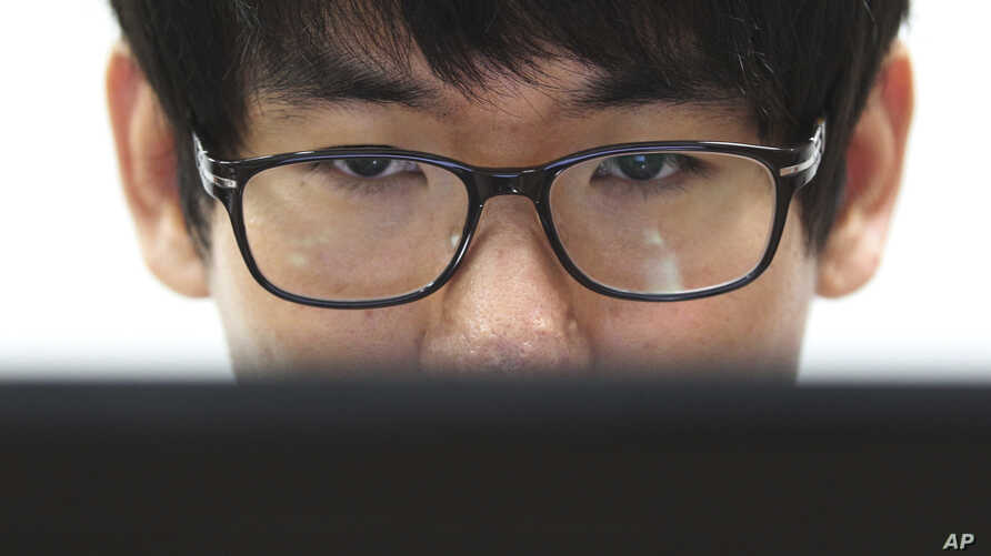 FILE - Simon Choi, a South Korean cybersecurity researcher, watches his personal computer during an interview in Seoul, South Korea.