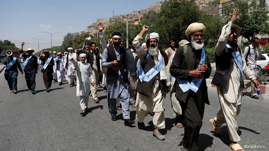FILE - Afghan peace marchers arrive in Kabul, Afghanistan, June 18, 2018.